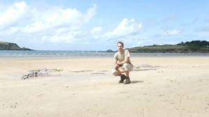 Tim on sunny deserted beach