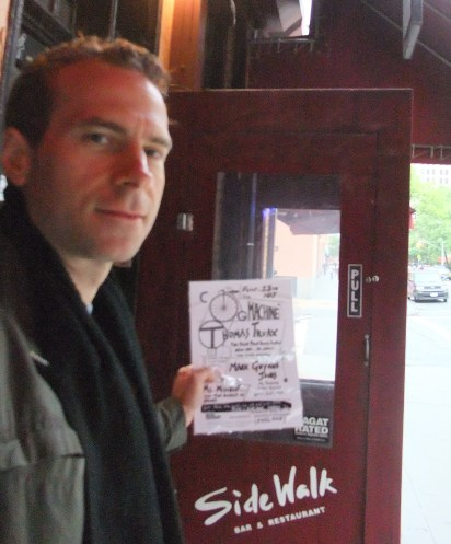 Tim about to flypost the Sidewalk Cafe
