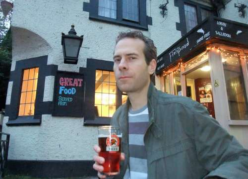 Yours truly with a pint of Tiger outside The Fishpond