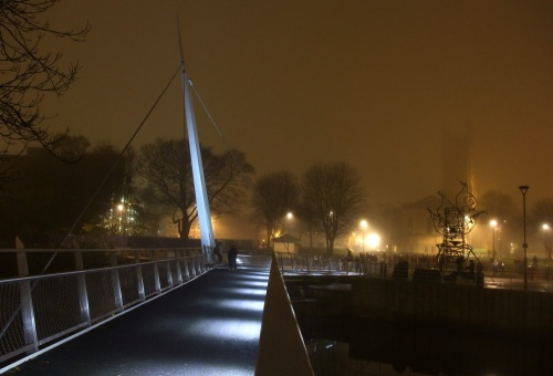 Foggy outline of Cathedral from footbridge