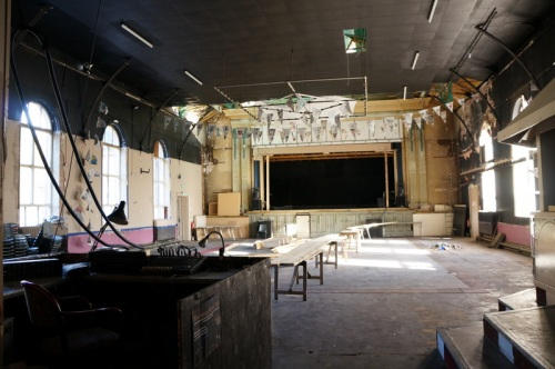 the ballroom with the original curved roof obscured by a suspended ceiling